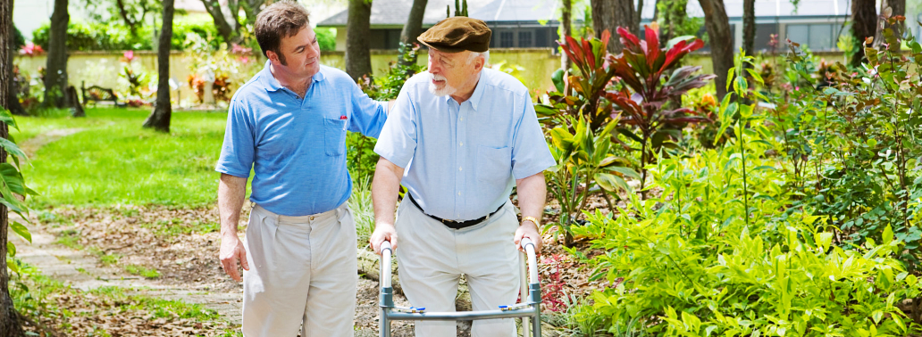 caregiver assisting the patient in walking
