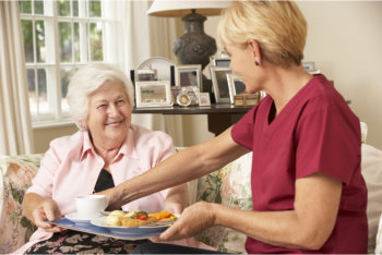 caregiver preparing food for the patient