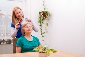 caregiver combing the patients hair